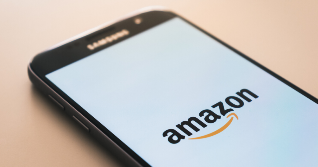 The Amazon logo displayed on a cell phone screen.