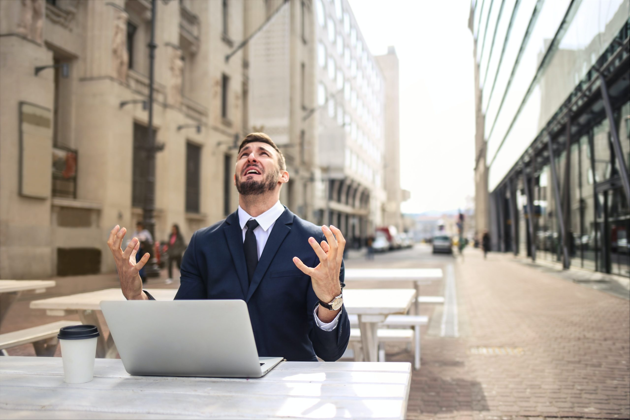 A businessman crying out in stress because he doesn't understand intangibles.