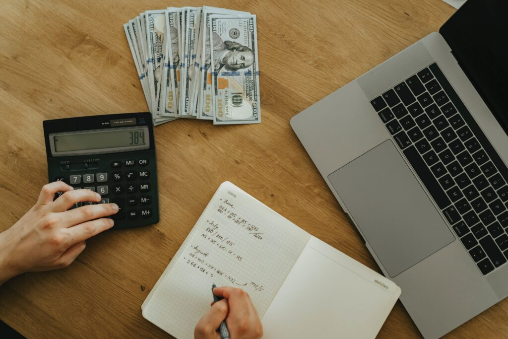 A photo of a small business owner doing their bookkeeping by hand. Little does he or she know that there are tips that can make the process a whole lot easier.