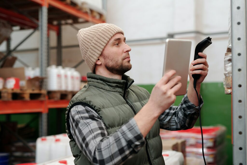 A man with a barcode scanner takes stock of his inventory.