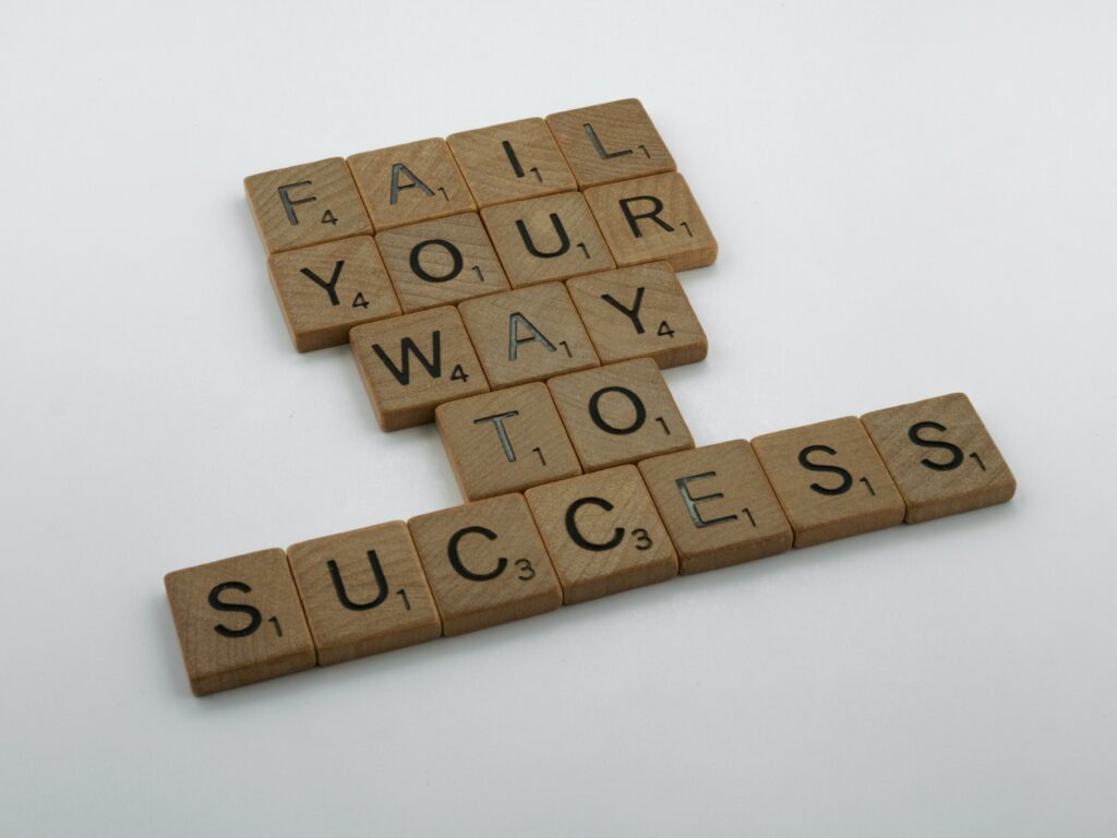 """The words """"fail your way to success"""" written out in Scrabble words."""
